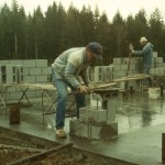 Jim Odle and Tom Permenter laying cement blocks.