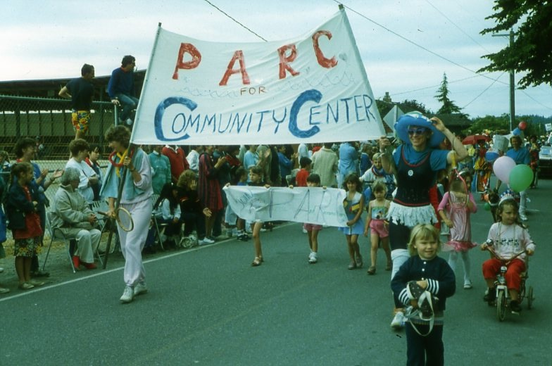 P.A.R.C. marchers with Georgia Scriven and Susan Knickerbocker holding the P.A.R.C. banner.