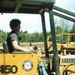Ladd Wilmoth operating a bulldozer donated by Stonebridge Construction.