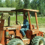 Curt Gordon, project coordinator, digging trenches for lateral drains using trencher donated by Karl Krieg.